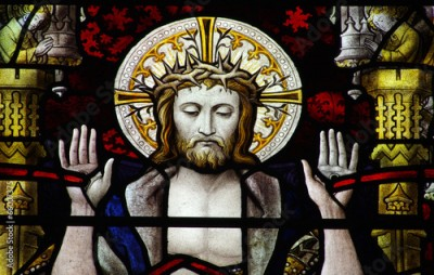 Naklejka Jesus Christ showing with his stigmata in stained glass