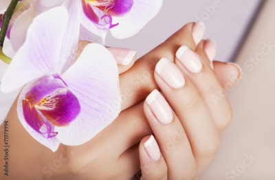 Obraz Beautiful woman's nails with french manicure.