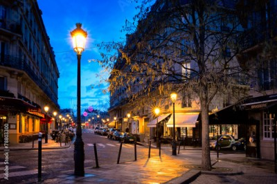 Obraz na płótnie Paris beautiful street in the evening with lampposts