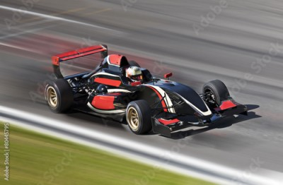 Fototapeta F1 race car racing on a track with motion blur