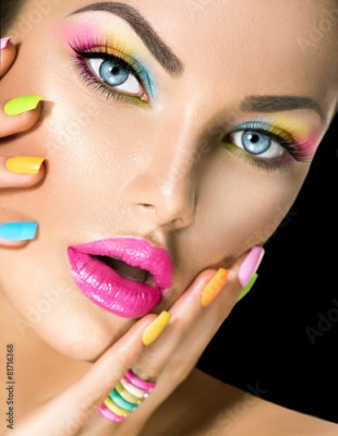 Obraz Beauty girl face with vivid makeup and colorful nail polish