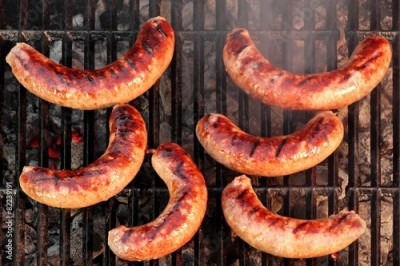 Fototapeta BBQ Bratwurst Sausages On The Hot Grill, Top View
