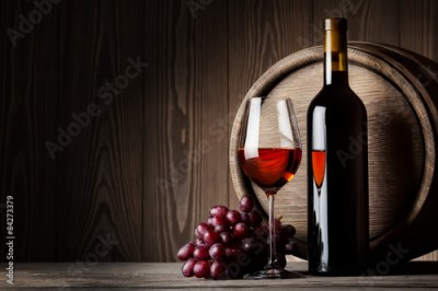 Obraz Black bottle and glass of red wine with grapes and barrel