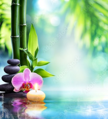 Fototapeta spa still life - candle and stone with bamboo in nature on water