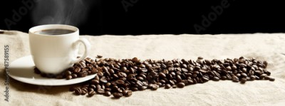 Fototapeta Panoramic view of frothy coffee cup with beans on fabric flax