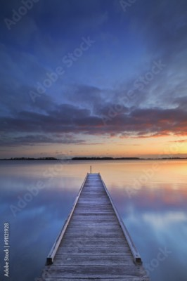 Obraz na Szkle Jetty on a lake at sunrise, near Amsterdam The Netherlands