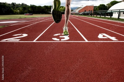 Fototapeta Run on athletic track