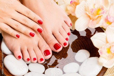 Obraz Beautiful female feet at spa salon on pedicure procedure
