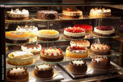 Obraz na Szkle Different types of cakes in pastry shop glass display