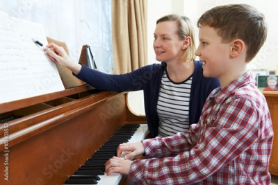 Fototapeta Boy With Music Teacher Having Lesson At Piano