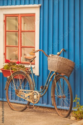 Obraz Old rusty lady bicycle in front of a Swedish house