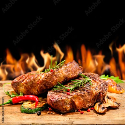 Fototapeta Grilled beef steak with flames