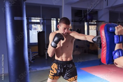 Fototapeta kickboxing man in gym