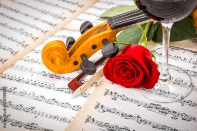 Obraz Close view of violin scroll, bow, red rose and wine
