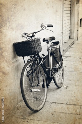 Obraz Vintage red bicycle with wicker basket at the street in Italy