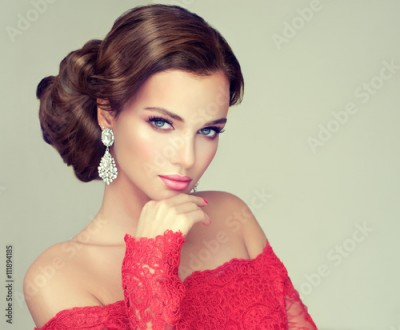 Fototapeta Beautiful model with elegant hairstyle . Beautiful woman with fashion wedding hairstyle with trend makeup .