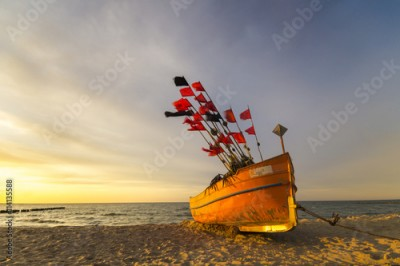 Plakat sunset over the beach sea, fishing boat on the beach