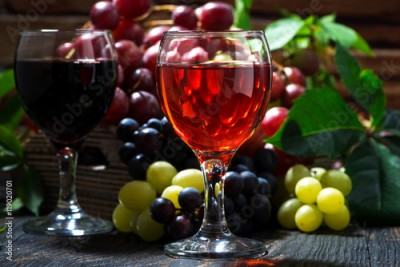 Obraz assortment different wine on dark wooden background, closeup